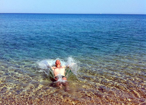 A slash in the crystal waters of Skala beach